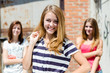 Three young happy teenage girls have fun in city outdoors