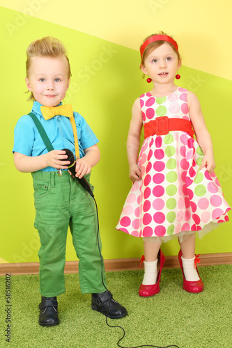 Boy with microphone and girl in bright clothes