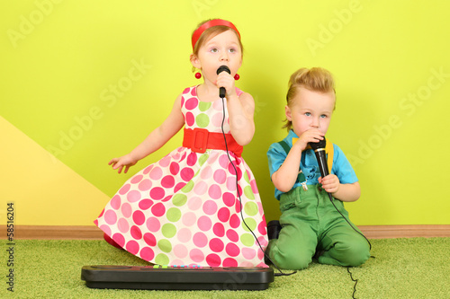 Mods girl and boy in bright clothes singing