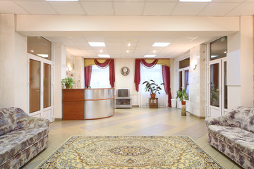 Light hallway with sofas and reception area