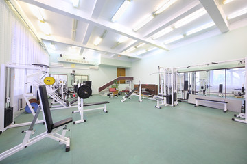 Spacious well lit empty gym with special equipment