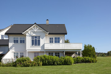 Modern white wooden house in Norway