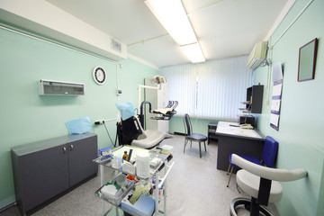 Contemporary empty dental office with dental chair