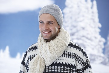 Winter portrait of happy young man