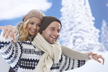 Loving couple having winter fun