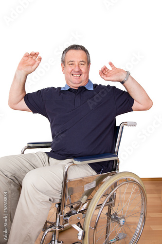 Man in wheelchair with stretching exercises