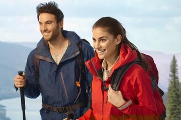 Happy couple trekking together