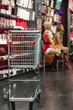 cart standing on floor in store near shelves with underwear