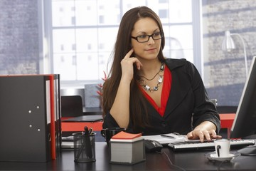 Office portrait of working businesswoman
