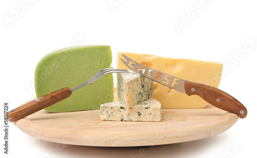 Various types of cheeses on wood