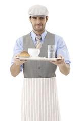 Elegant waiter holding tray
