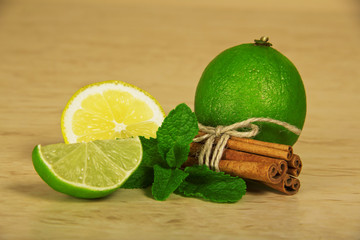 Cinnamon sticks with rope, slice of lemon and lime