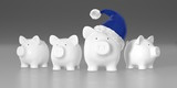 Piggy bank - group with big pig with blue santa hat
