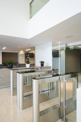 Security turnstiles at business center in modern style