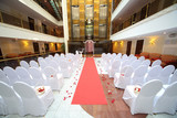 A beautiful empty hall for wedding ceremony with flower petals