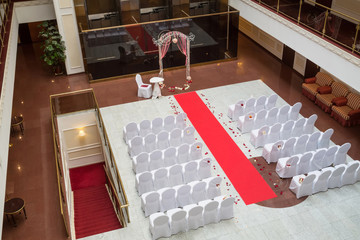Empty hall for wedding ceremony with flower petals