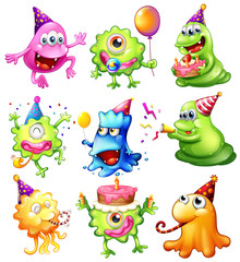 Happy monsters celebrating a birthday