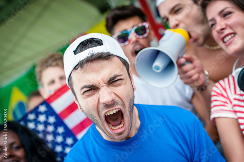 American soccer fan scream at stadium