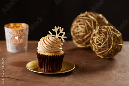 Snowflake cupcake on Christmas background