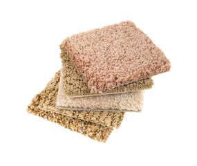 Small carpet sample squares stacked on a white background