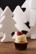 Raspberry and butter cream cupcake on Christmas background
