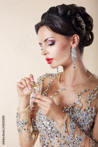 Portrait of Luxurious Caucasian Woman  with Perfume Bottle.