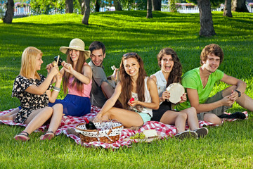 College students enjoying a picnic in the park.