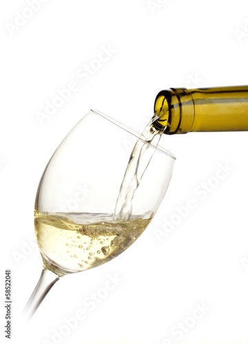 White wine poured into a glass