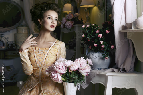 Girl in yellow retro dress with flowers