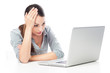 Worried woman using laptop