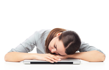 Tired woman sleeping on laptop