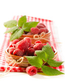 Fresh raspberry in the bowl macro isolated on white