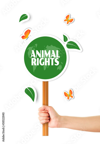 Hand holding green animal rights sign