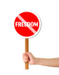 Hand holding freedom red sign
