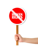 Hand holding red human rights sign