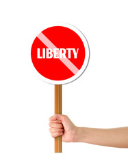 Hand holding liberty red sign