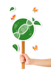 Hand holding green sign with dna