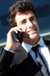Young businessman talking with smartphone