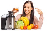happy woman is pressing the juice from the fruit
