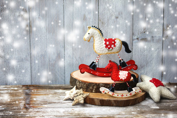 Rocking horse over wooden background / Vintage christmas card