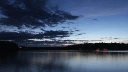 Dusk to Night over the lake. Timelapse. Muskoka, Ontario.
