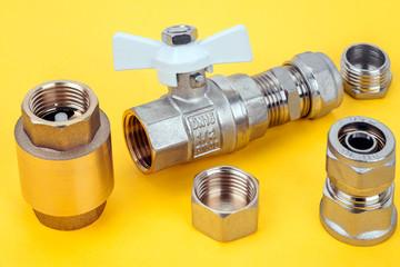 Plumbing parts on yellow