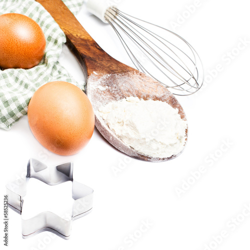 Festive cookie cutters,  eggs and flour for baking cookies isola
