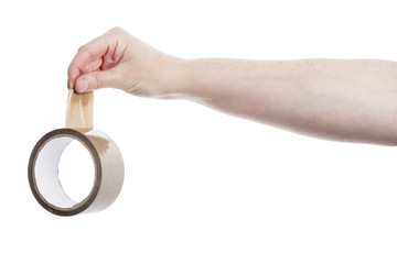 Hand holding roll of adhesive tape
