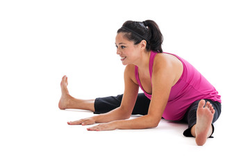 Pregnant woman stretching legs and back