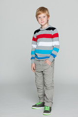 Red-haired boy on the grey background