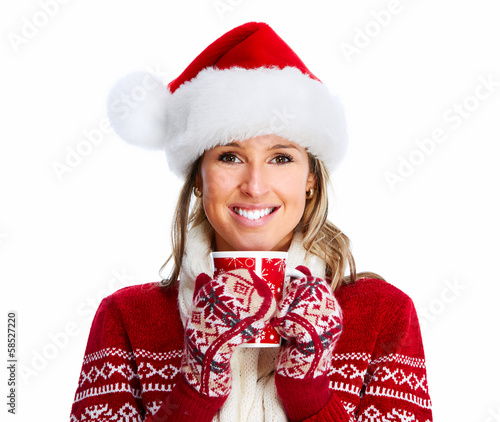Christmas woman drinking hot tea.