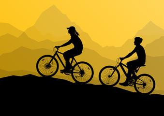 Active cyclists bicycle riders in wild mountain nature landscape