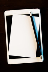 blank white paper,classic pencil  with tablet  on wooden backgro
