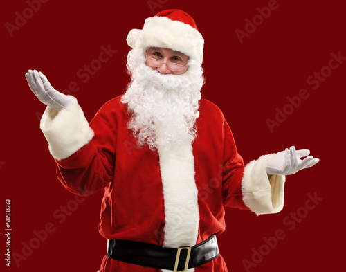 Santa Claus gesturing his hand isolated. Presenting something